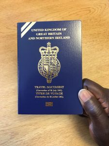 a person holding a travel document