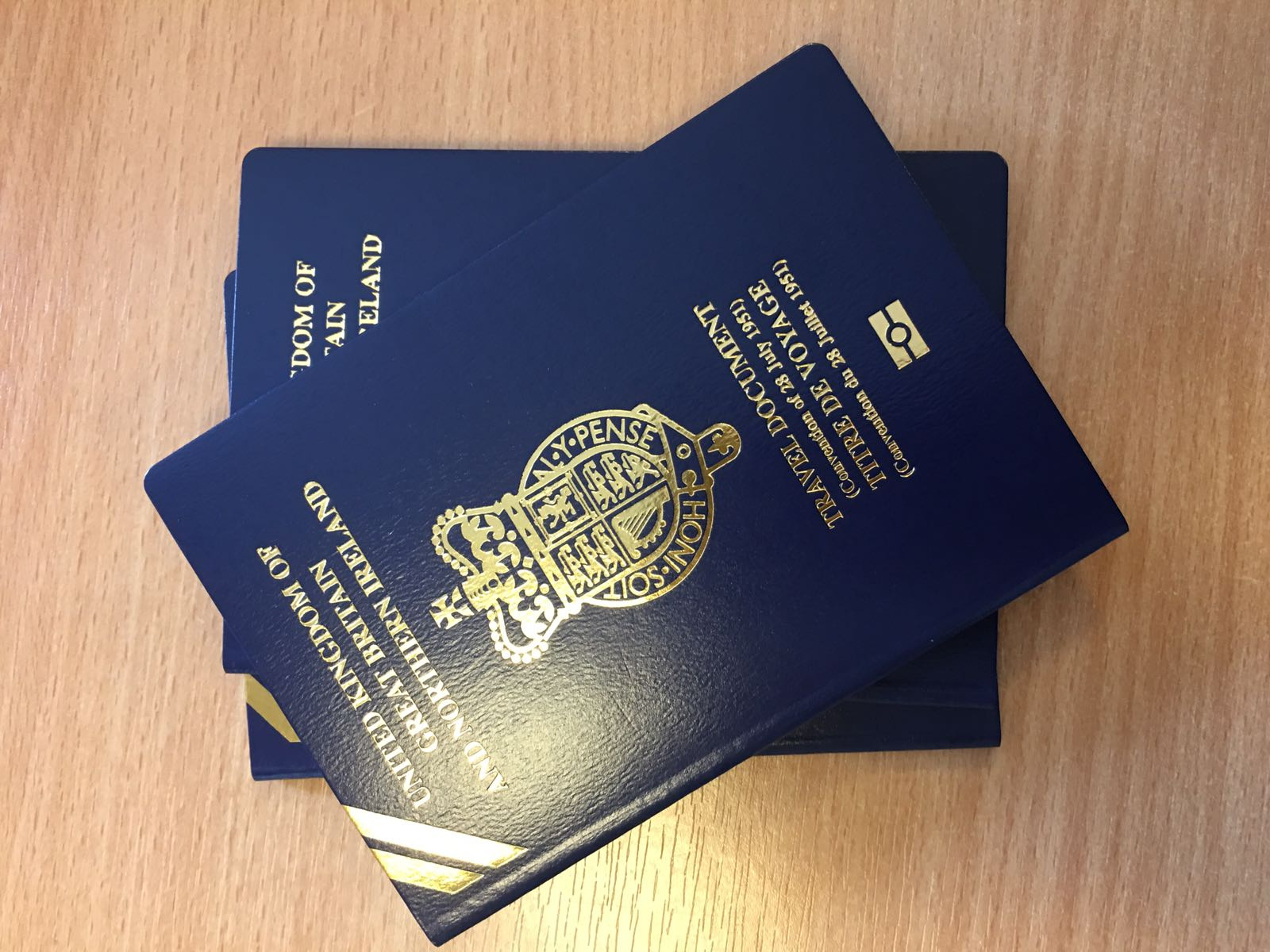 a stack of travel passports